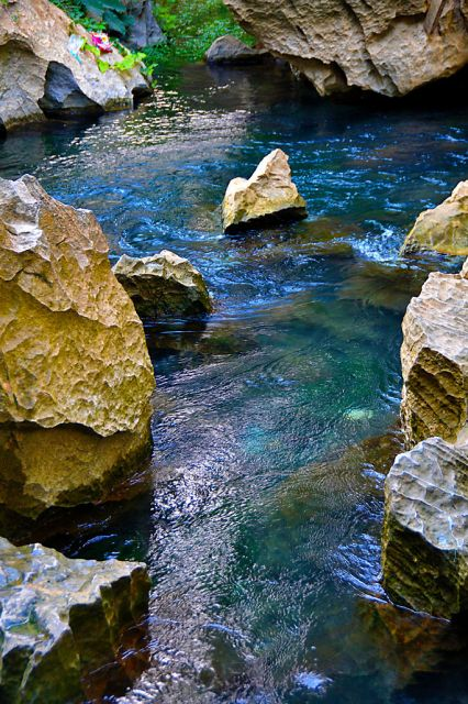 Crystal clear water flowing from caves